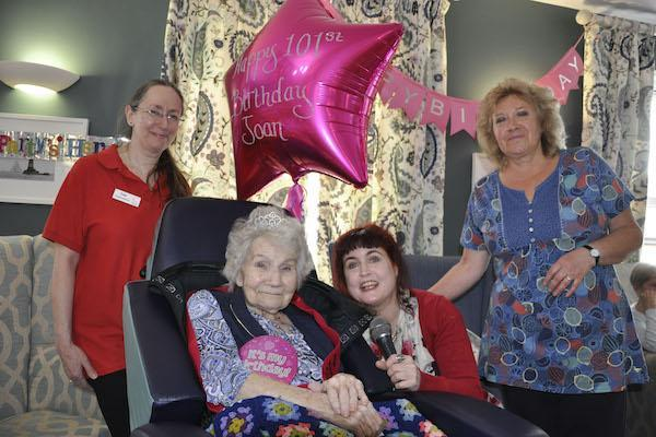 HAPPY BIRTHDAY. Joan Waddington is serenaded on her 101st birthday at Colten Care's Avon Reach care home in Mudeford, Dorset, by singer Scarlett Bow. With them are Companionship Team Member Lisa Sutcliffe, left, and Companionship Volunteer Jan Smith.