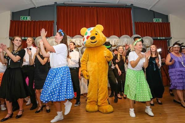 Colten Care residents and team members with Pudsey Bear at their Strictly Come Tea Dance in Lymington in aid of Children in Need.
