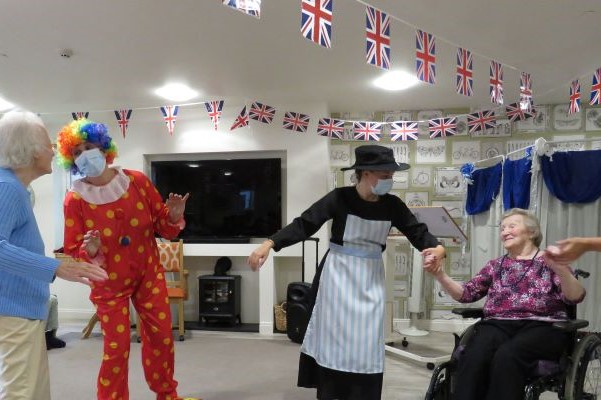 dressed up characters and elderly residents