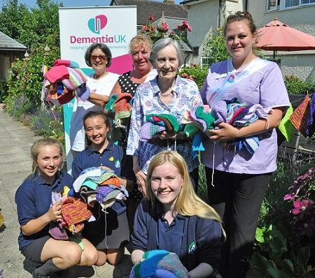 Colten Care home residents and Priestlands pupils knit squares for the record attempt