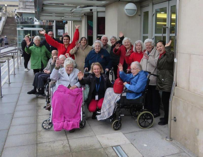 Music and Arts Partner Fiona Pritchard, sitting centre, with residents and team members from various Colten Care homes on a trip to Pavilion Dance South West in Bournemouth.