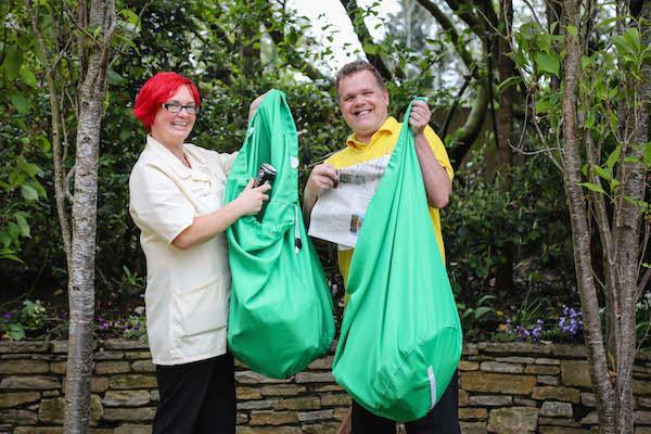 GREEN CHAMPIONS. Domestic Assistants Debbie Pepper and Martin Cannings with cloth sacks for removing rubbish and waste. By switching to washable, re-usable sacks, Colten Care has eliminated the need for some 365,000 plastic bin bags a year.