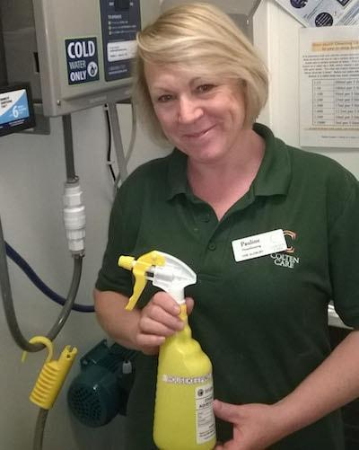 IT'S MAGIC. Pauline Wilford, a member of Colten Care's housekeeping team, is pictured by an anti-bacterial 'magic water' dispenser. Such dispensers are expected to see 19,000 fewer plastic bottles used per year when their roll-out is complete across all 20 Colten Care homes.