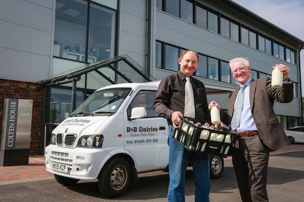 PINTA MILK. Nearby dairy business B&B Dairies now delivers fresh milk to Colten Care's Ringwood head office in recyclable glass bottles. Milkman Ken Bolton, left, checks a delivery with Fergus Davitt, Colten Care's Hotel Services Manager.