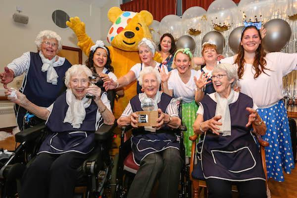 STRICTLY STARS. Colten Care residents and team members with Pudsey Bear at a Strictly Come Tea Dance in Lymington in autumn 2018 in aid of Children in Need.
