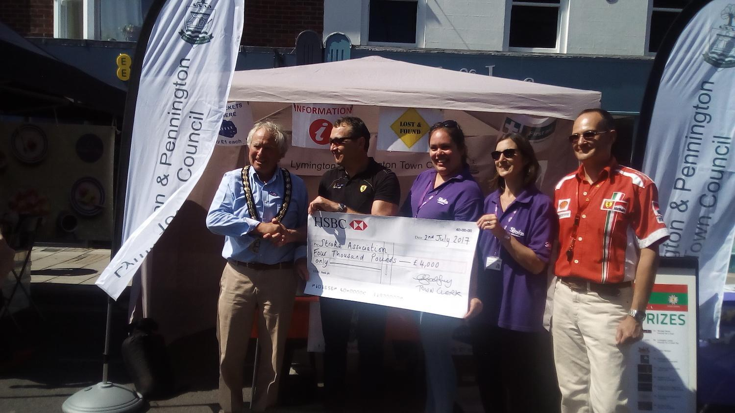 Italia Festival team hand over £4000 to the Stroke Association in Lymington
