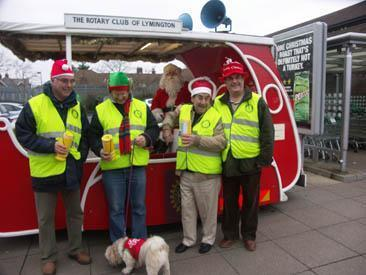 Father Christmas and his Rotary Elves with the Santa Sleigh in Lymington