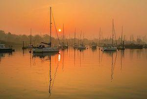 Lymington River at sunset by Steve Elson.
