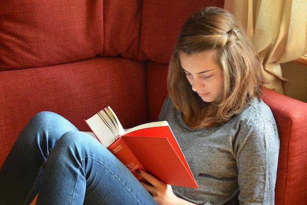teenage girl reading a book