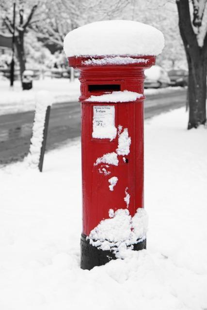 Post box covered in snow