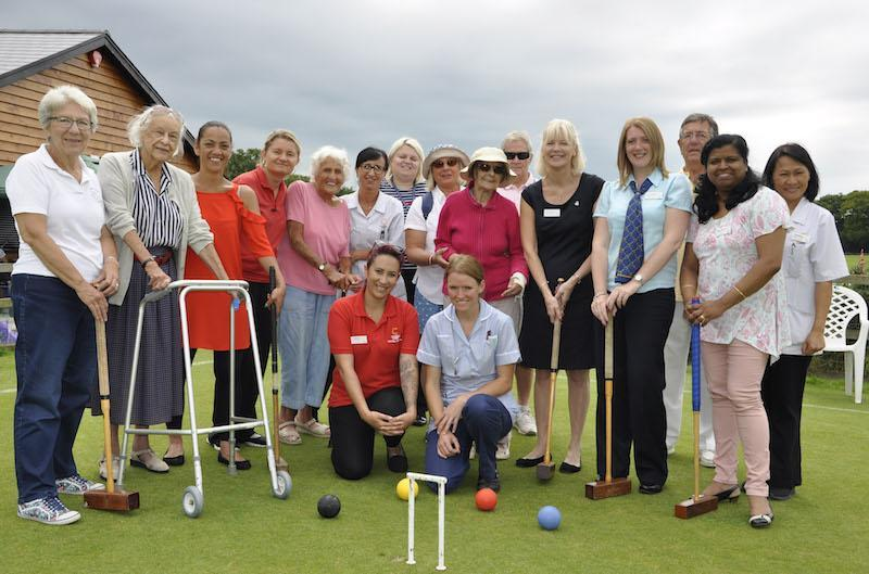 Residents, relatives and staff from Colten Care's Court Lodge with members of Lymington Croquet Club at Woodside Gardens