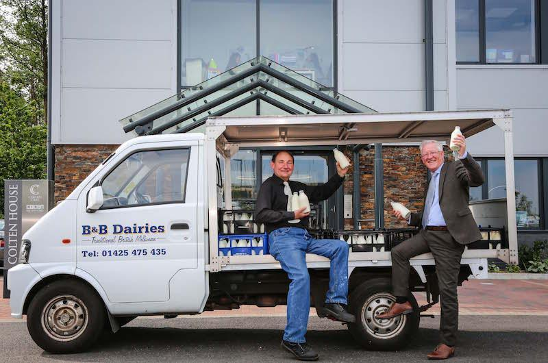 A nearby dairy business, B&B Dairies, now delivers fresh milk to Colten Care's Ringwood head office in recyclable glass bottles. Milkman Ken Bolton, left, checks a delivery with Fergus Davitt, Colten Care's Hotel Services Manager.