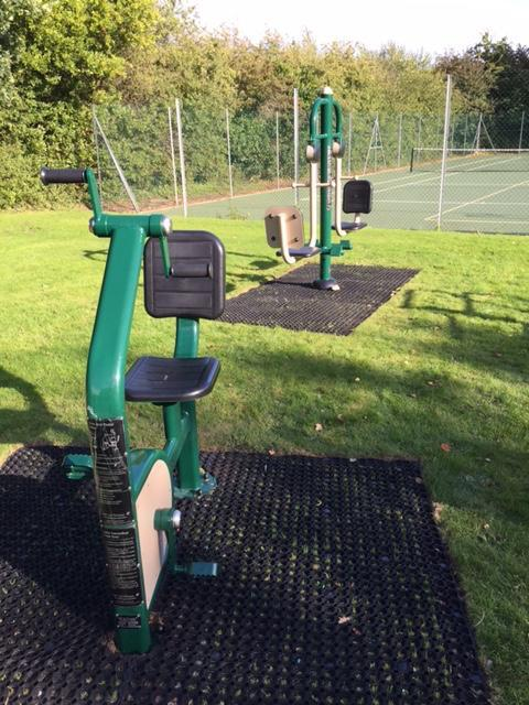 Leg press and cycle at Lymington Woodside Gardens Outdoor Gym
