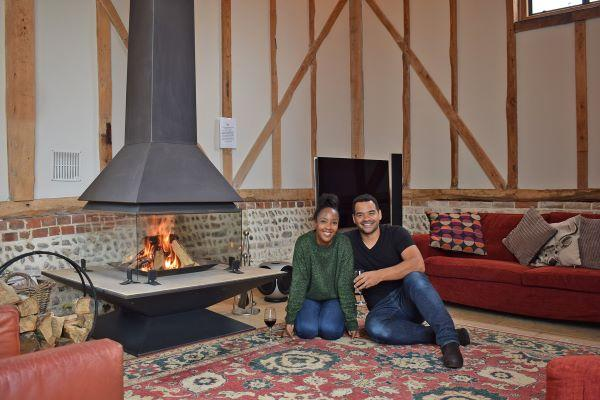 couple sitting beside the cosy fireside
