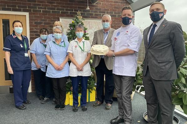 Oakhaven Nurses and Professor Paul Dobson, Chairman receive Thank You cake donated by Royal Lymington Yacht Club and Mosimann's