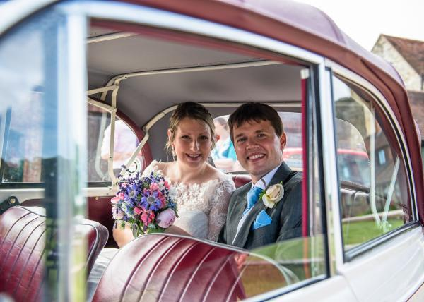 Couple in wedding car at the Walled Garden, Cowdray, Sussex