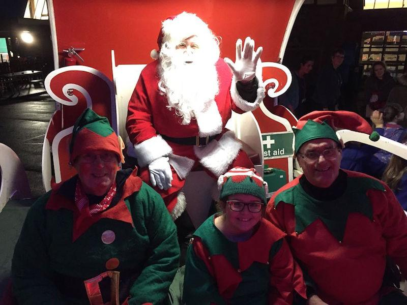 Santa and his eleves on the old sleigh