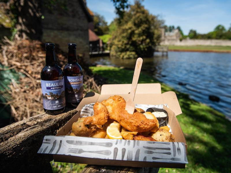 Takeaway fish and chips to eat by Beaulieu River in the summer