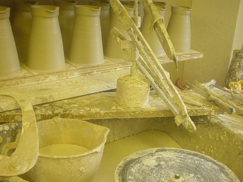 Making pots on the potters wheel at Vinegar Hill Pottery