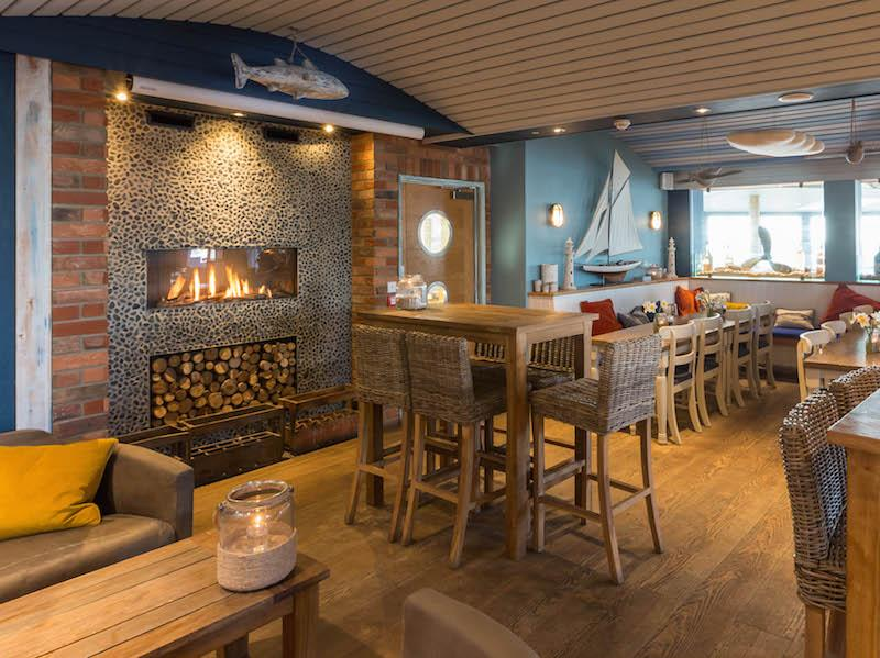 Warm up after a sea wall walk in the cosy Haven Bar